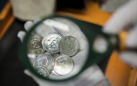 В Украине введены в оборот новые монеты номиналом 1 и 2 гривны