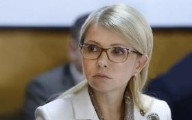 Тимошенко с молодым человеком засняли перед рейсом в Европу: появились фото