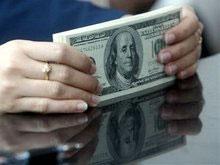 Нацбанк Украины понизил официальный курс доллара