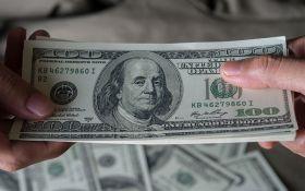 Долари, патрони і наркотики: співробітника СБУ спіймали на хабарі