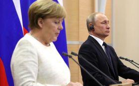 Кремль: Путін говорив з Меркель про особливий статус Донбасу
