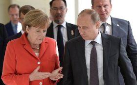 Путін і Меркель обговорили Донбас та вбивство Захарченко