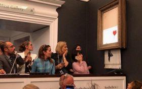 Картина Бенксі самознищилася після продажу за 1,4 млн доларів на аукціоні: видовищне відео